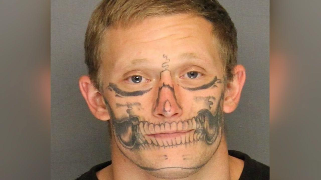 Escapee with skeleton face tattoo, captured in California