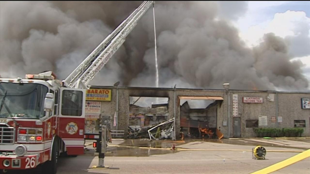 Massive warehouse fire burns