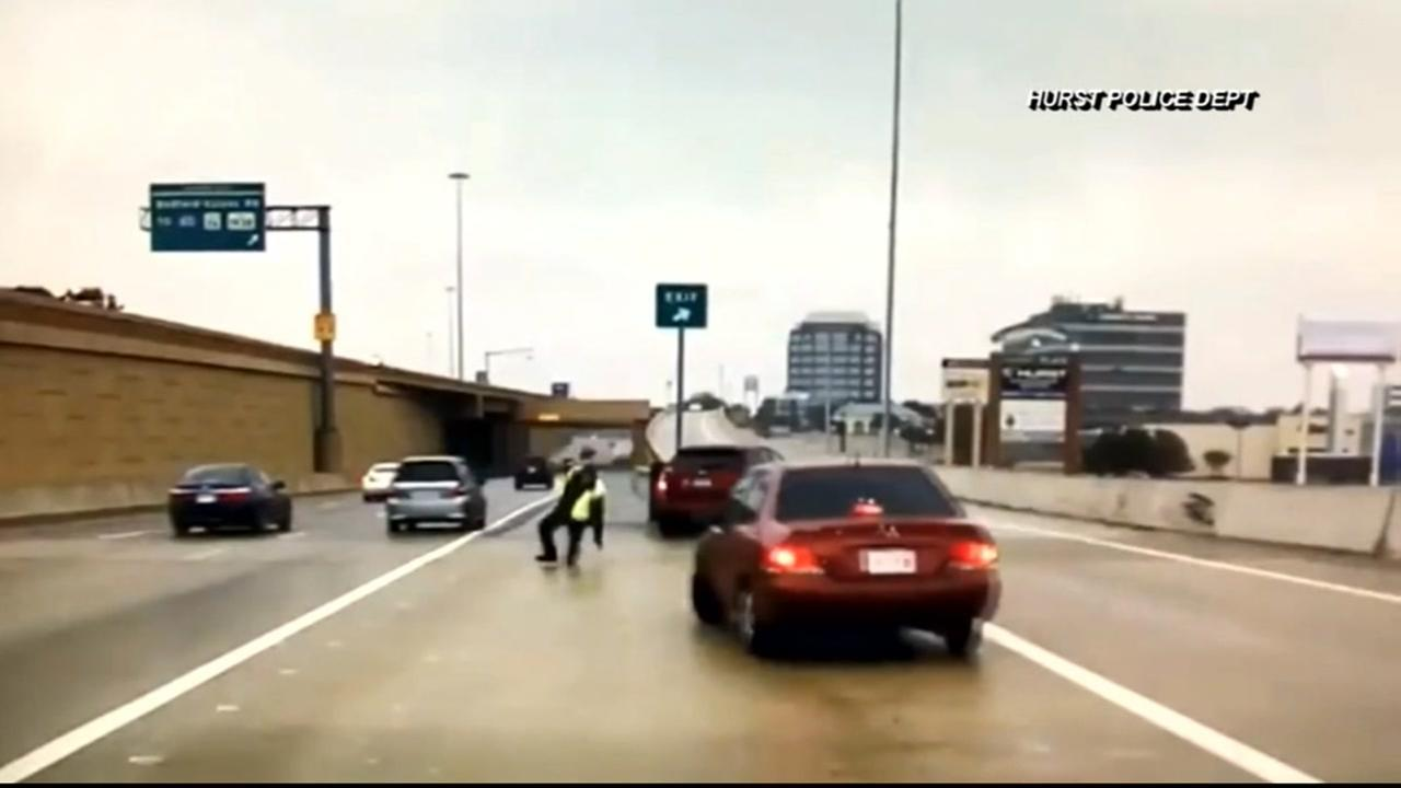 Car narrowly missed hitting officer on icy road