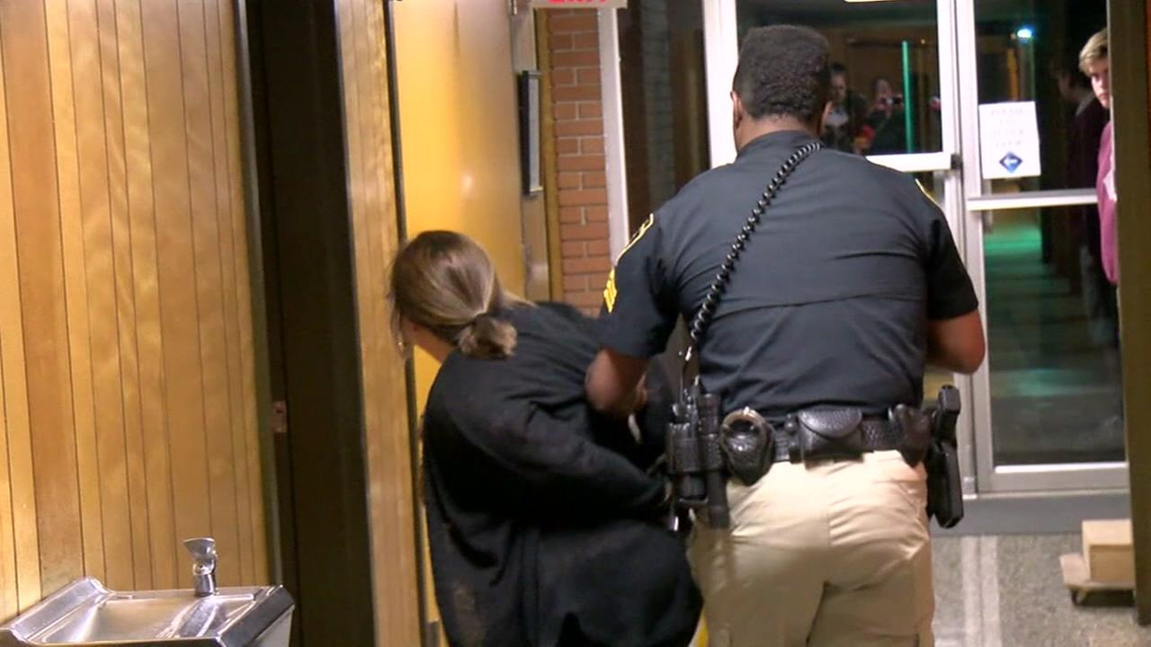 Teacher handcuffed at school board meeting