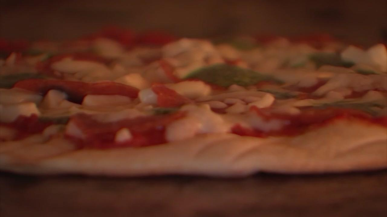 Pizza with a purpose: Local pizza shop donates a meal to Africa for every pie sold