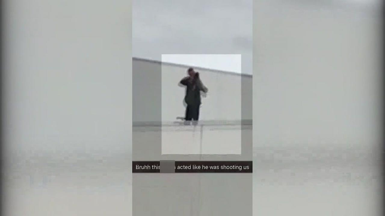 Security guard caught on video pretending to point gun at kids