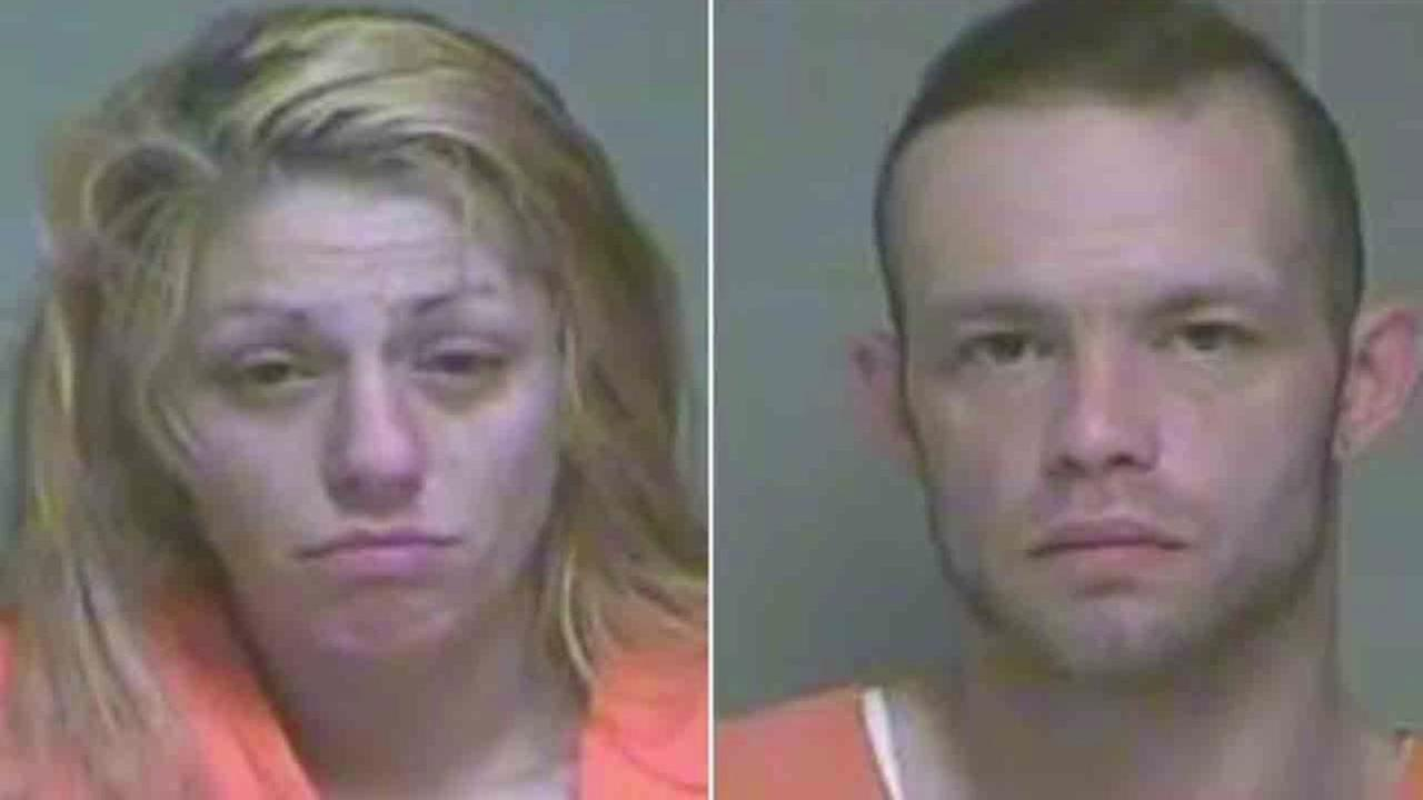 Police find couples twins buried under garbage, soaked in urine