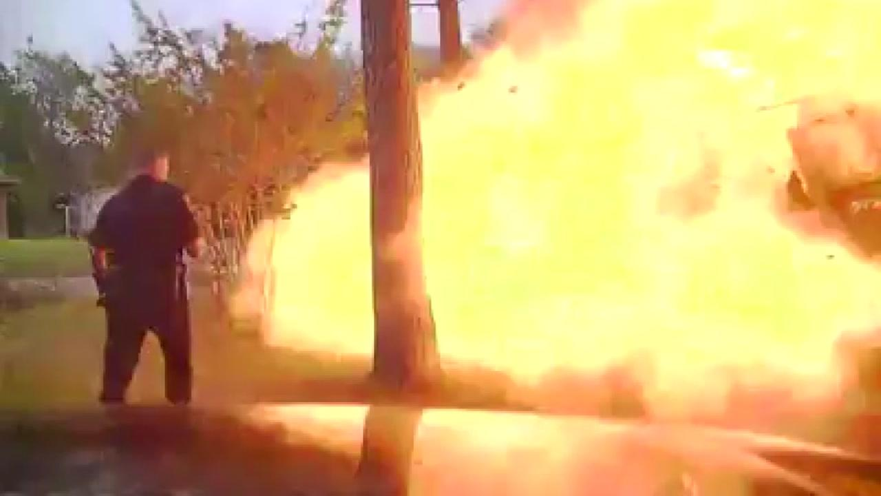 Dash-cam video of house exploding just as an officer makes the scene