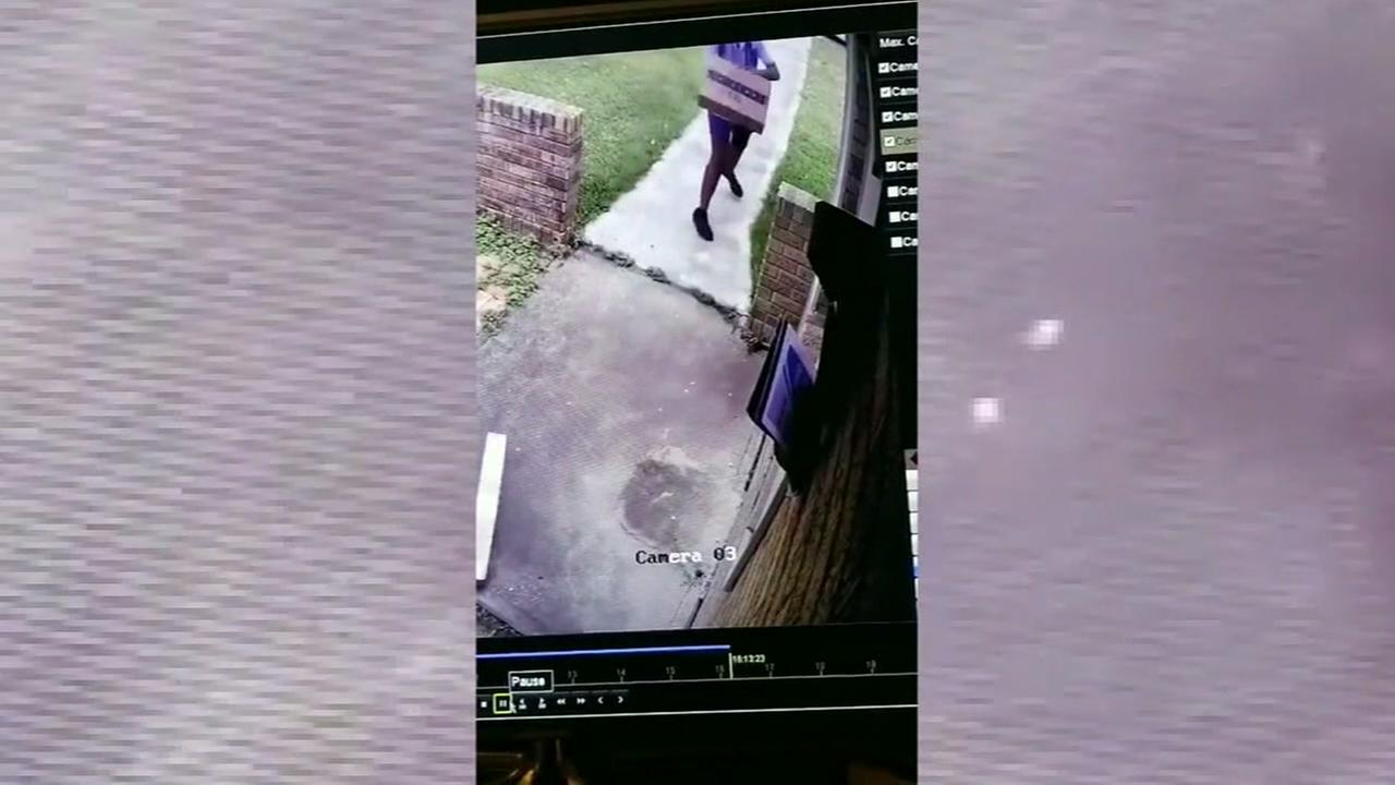 Postal worker tosses packages