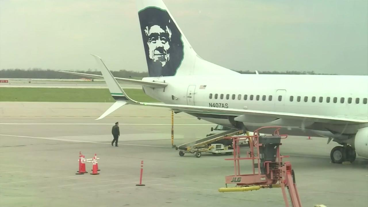A woman dies on an Alaska Airlines flight from Seattle to Kansas City.
