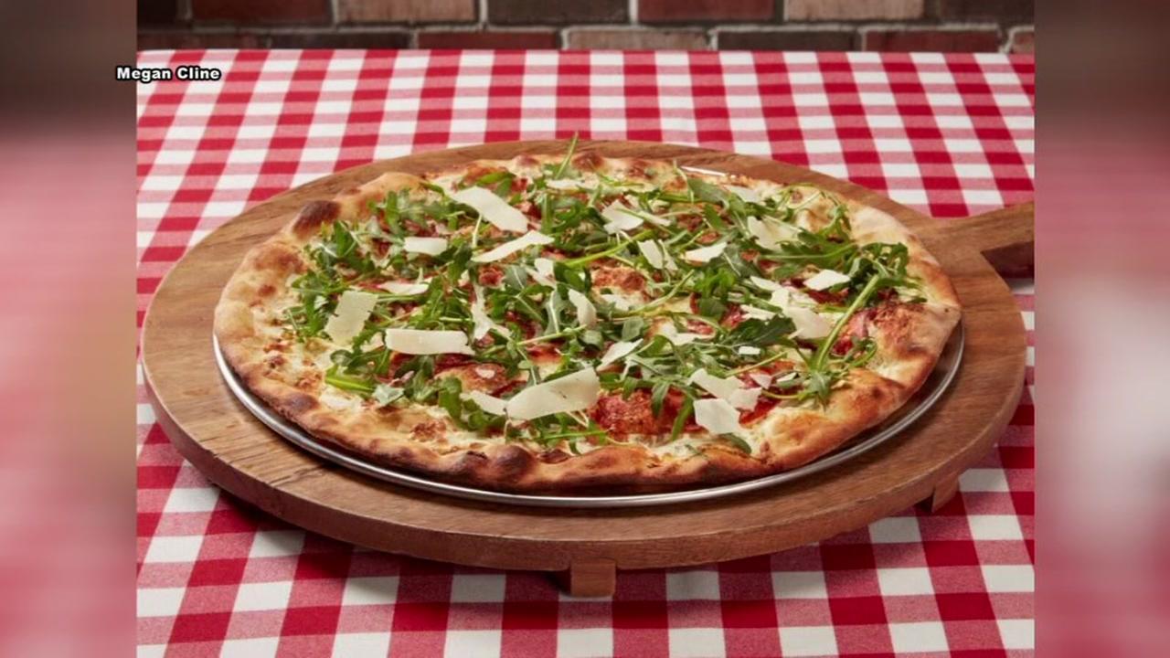 Grimaldis awarding free pizza party to teachers
