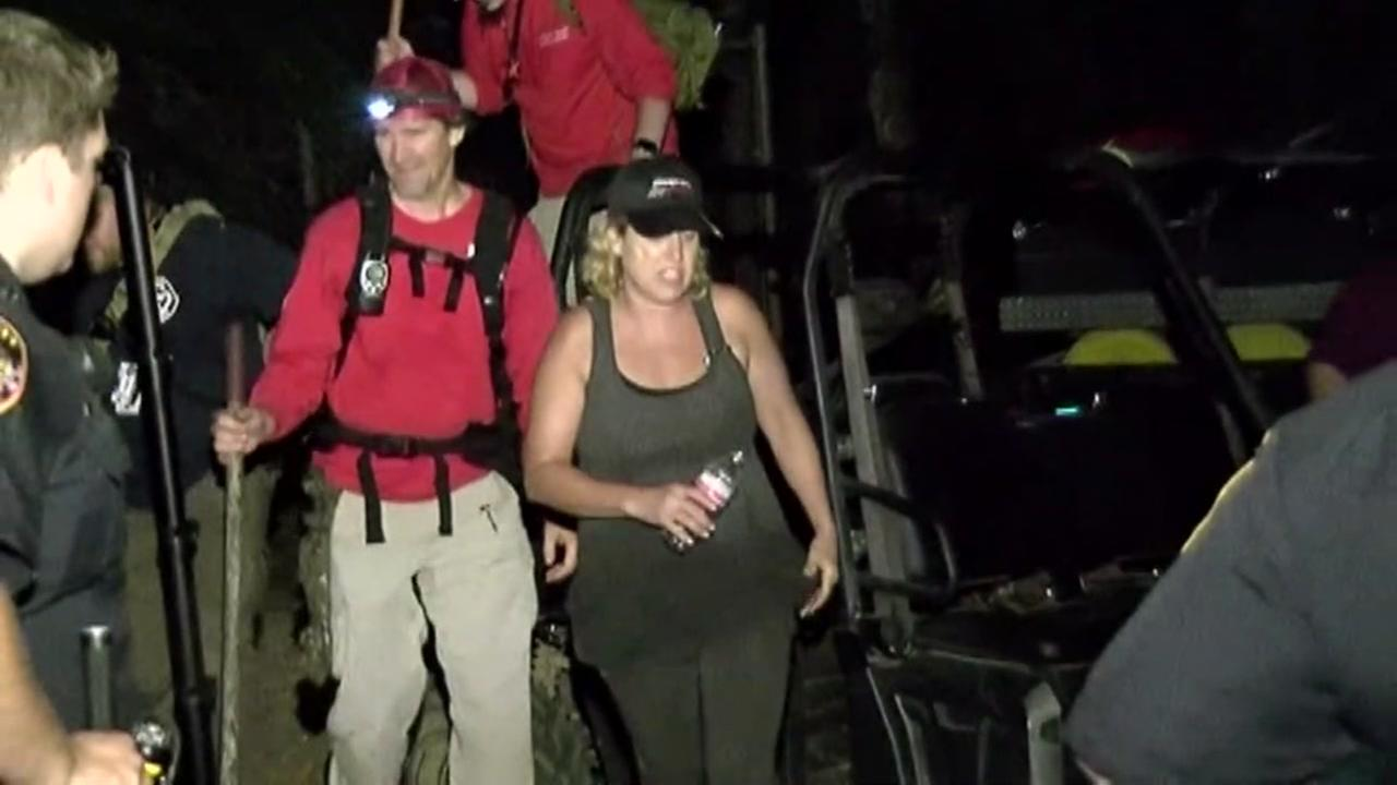Woman and her dog rescued after more than 15 hours in wooded area