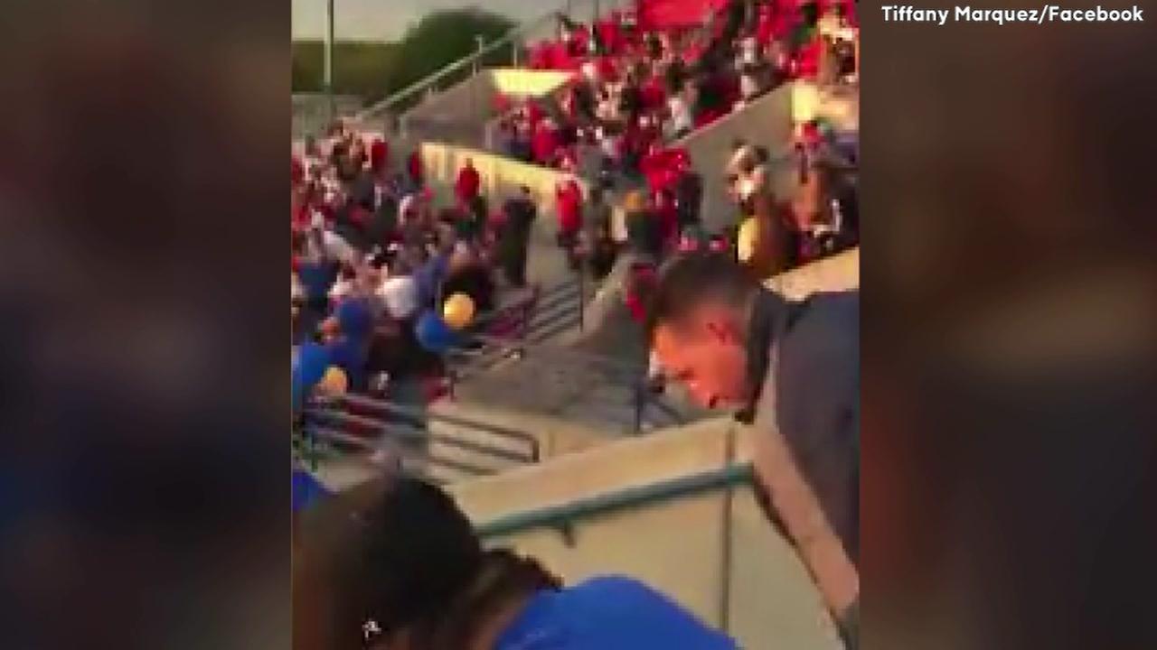 Crowd sings National Anthem at high school game