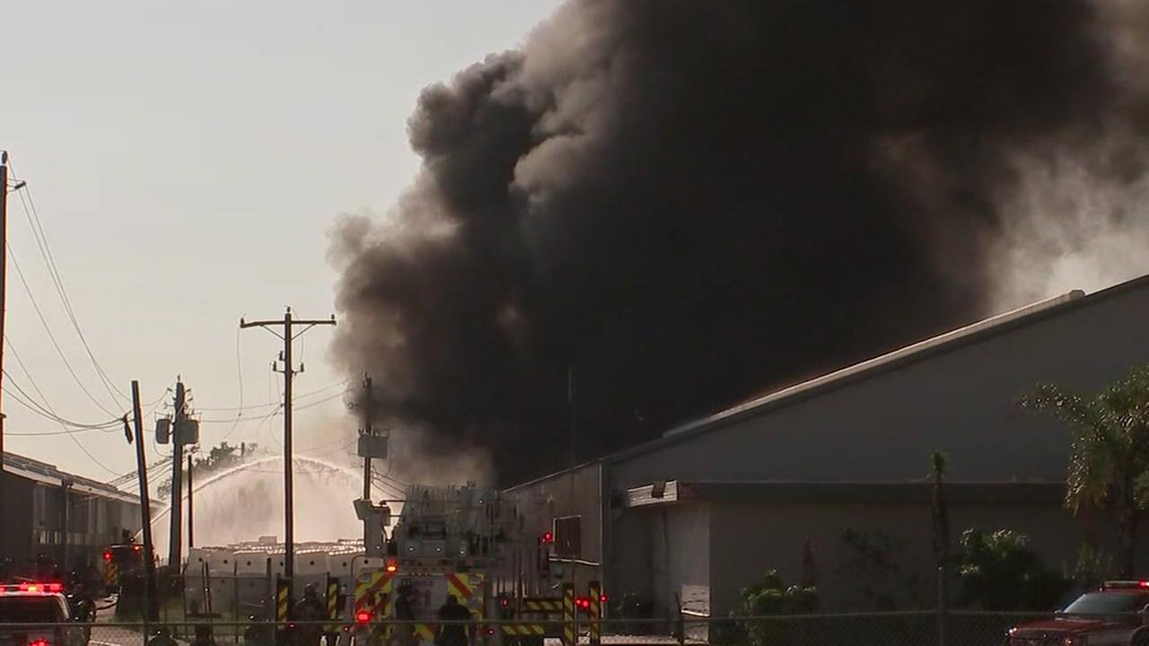 2 firefighters taken to hospital after 4-alarm fire at warehouse in SW Houston