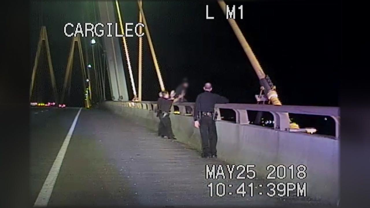 La Porte police officers rescue woman on railing of Fred Hartman Bridge