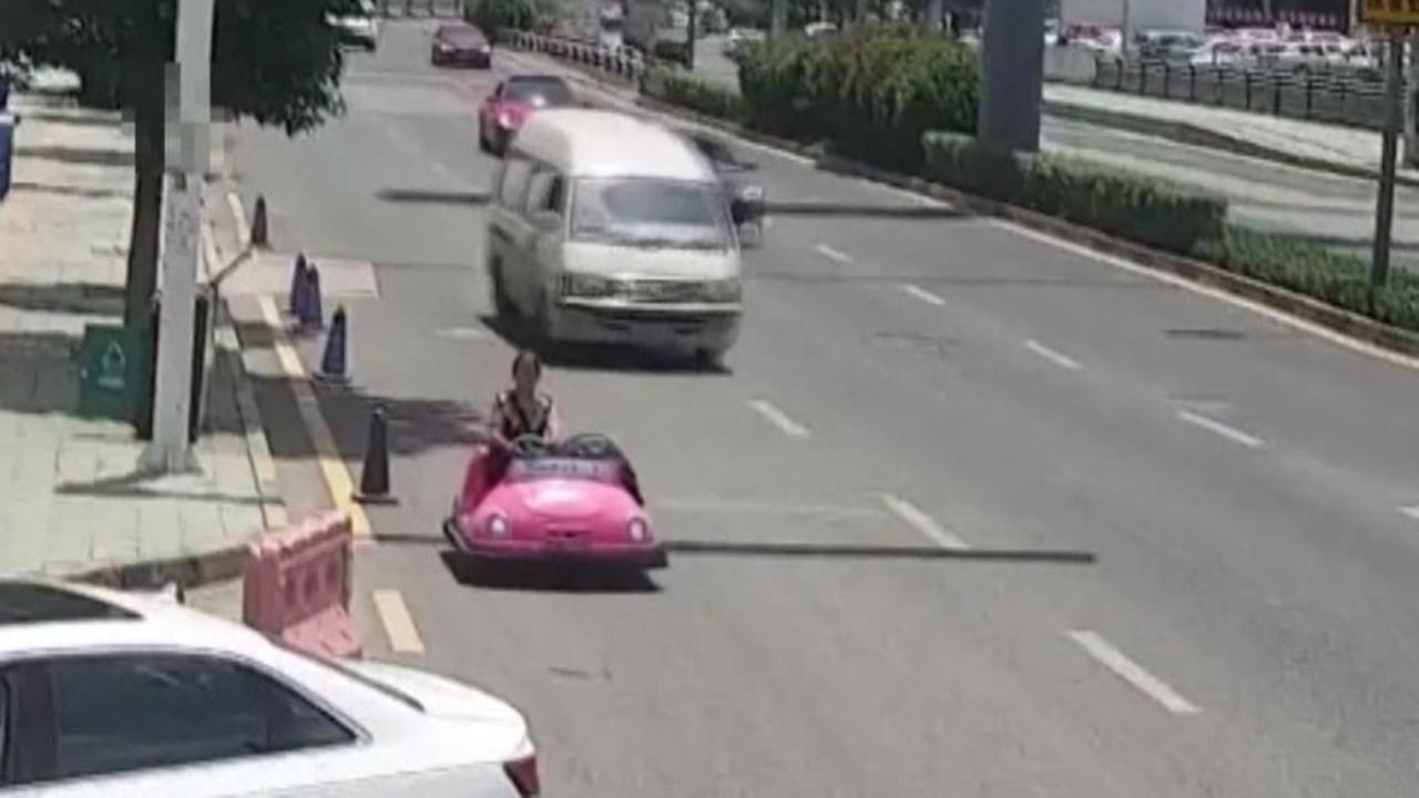 Woman pulled over for driving pink bumper car on street