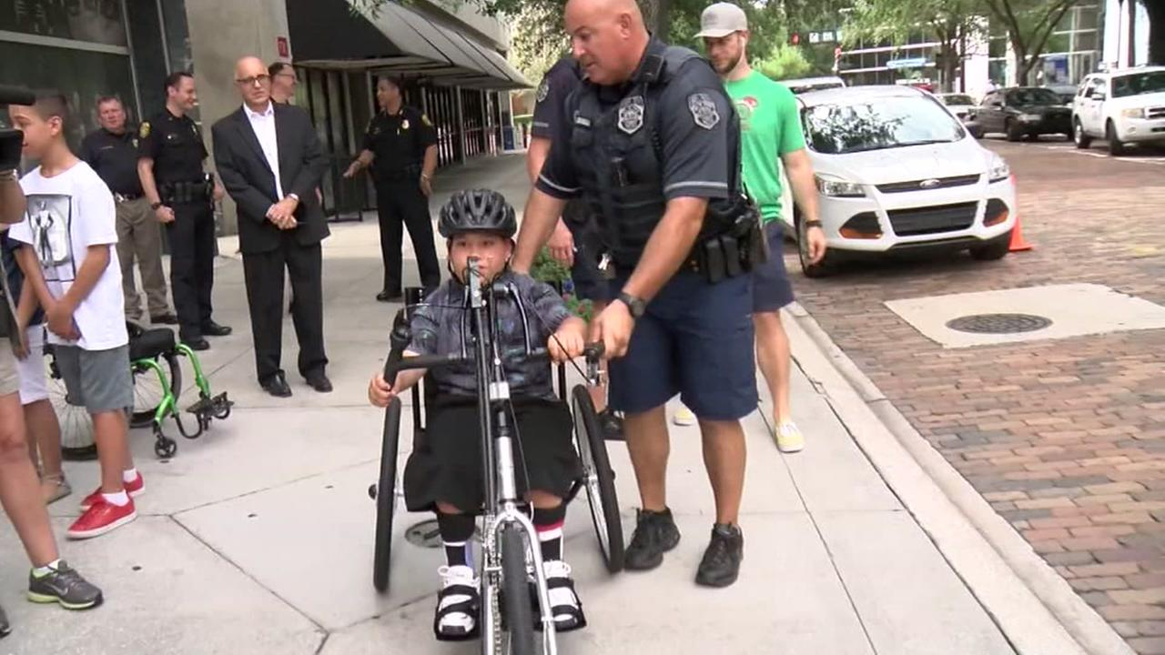 Officers surprise boy with disability