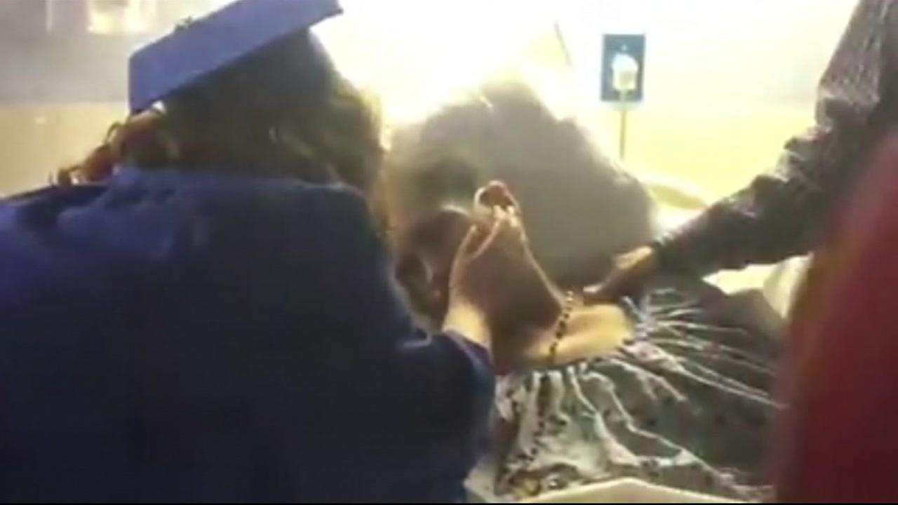 Mothers dying wish granted as she watches her daughter graduate