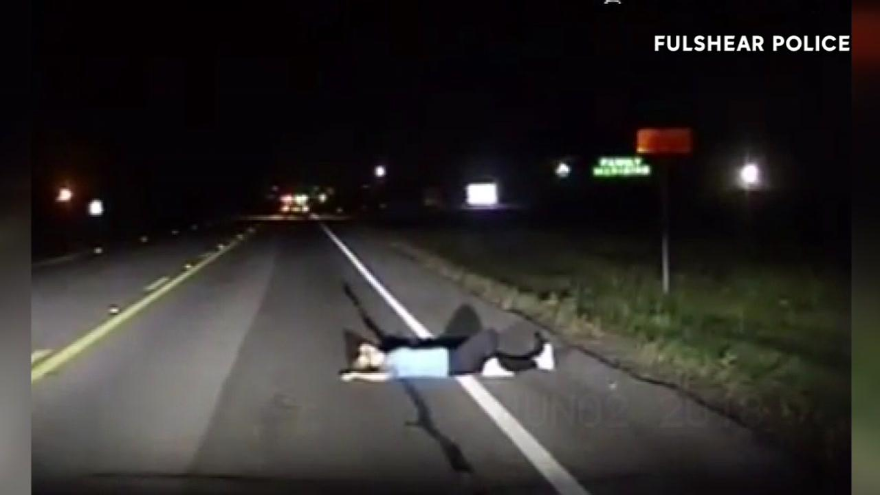 Cars narrowly avoid hitting woman sleeping on roadway