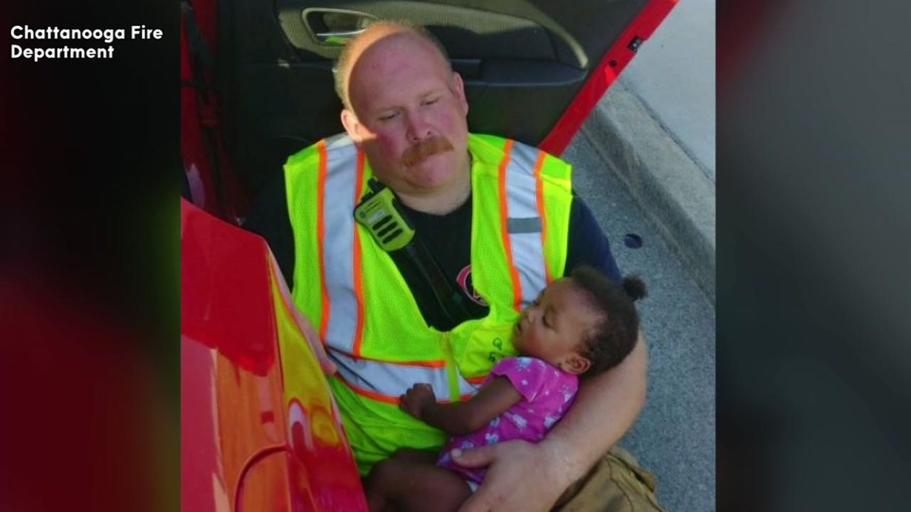 Picture of firefighter holding baby goes viral