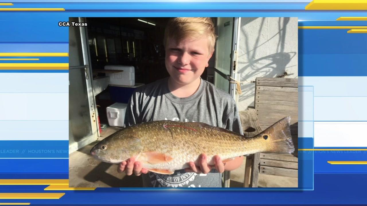 12-year-old boy wins $25,000 after catching massive redfish