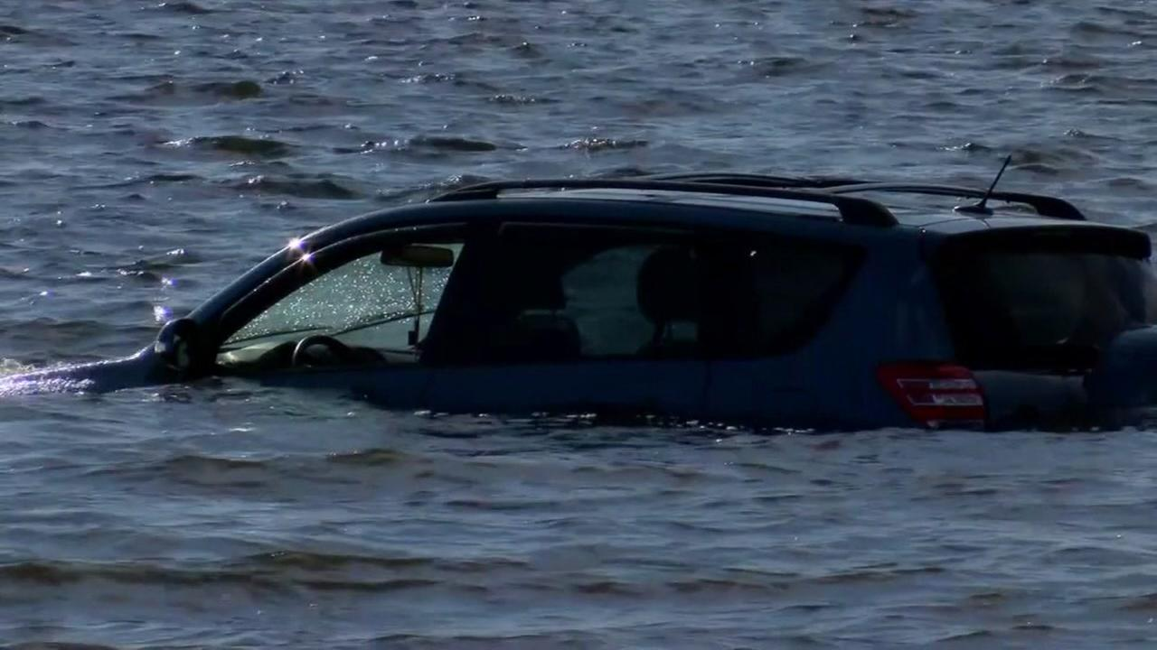 Mother arrested for purposely driving SUV into water with child inside
