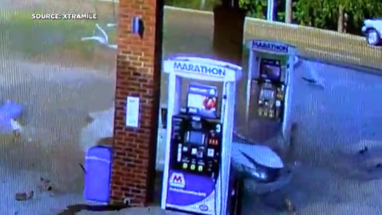 Car goes airborne and slams into gas station