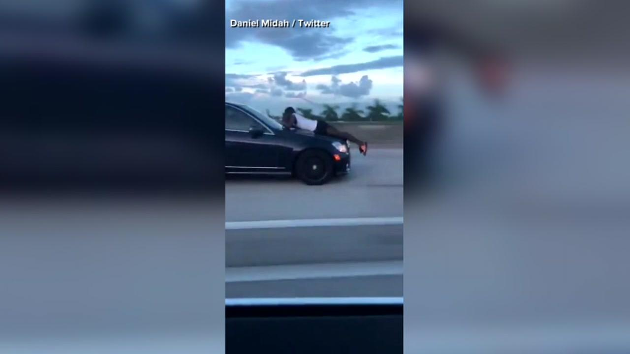 Video: Man rides on hood of car on highway in Florida