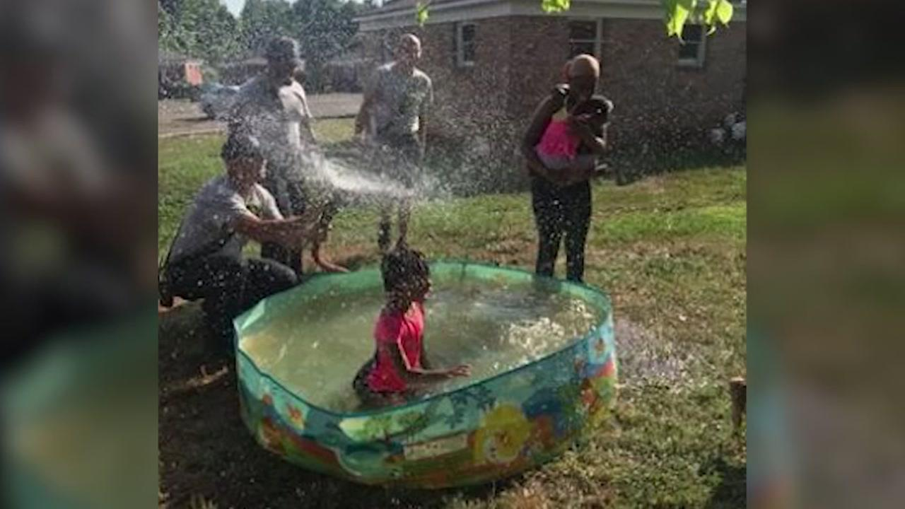 Firefighters help fill familys pool on a hot day