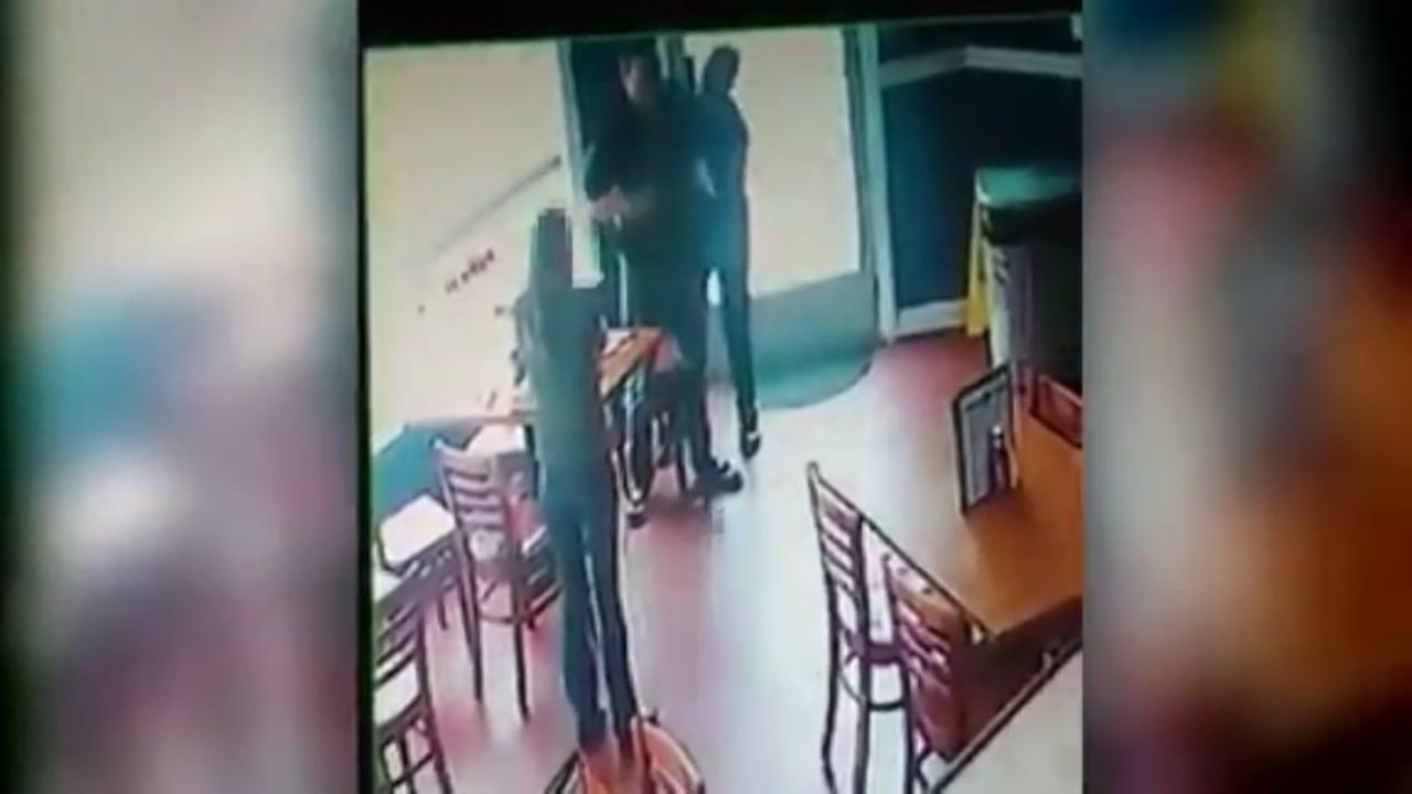Server saves choking man