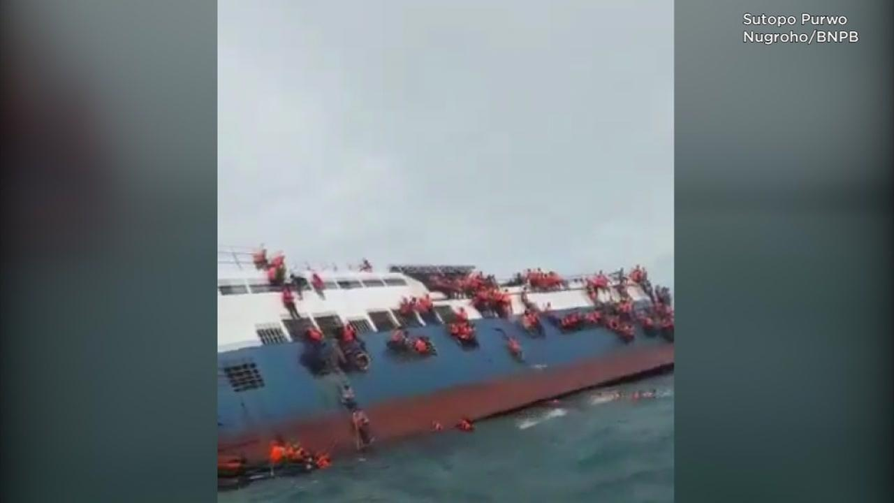 At least 12 dead as sinking ferry run aground off Sulawesi