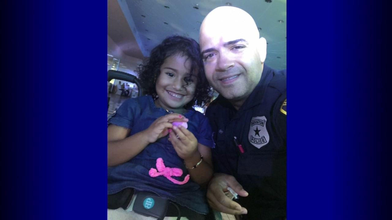 Officer shares sweet moment with girl in wheelchair