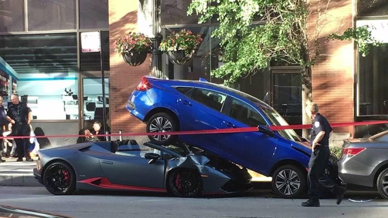 Lamborghini wedged beneath car; nobody injured