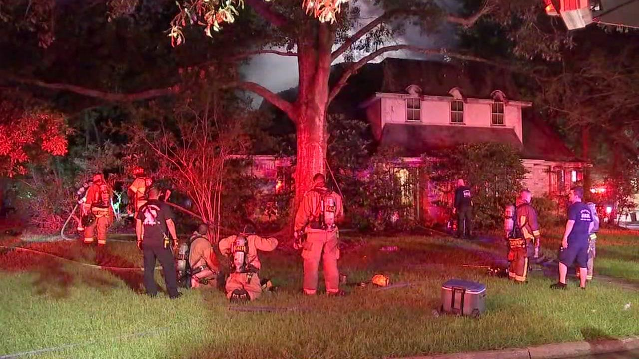 Firefighter falls through second story