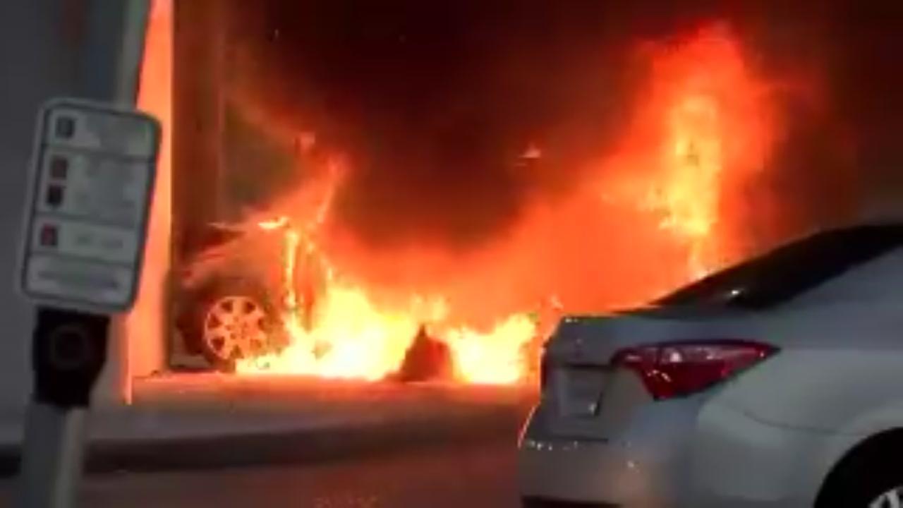 Flames engulf car following crash