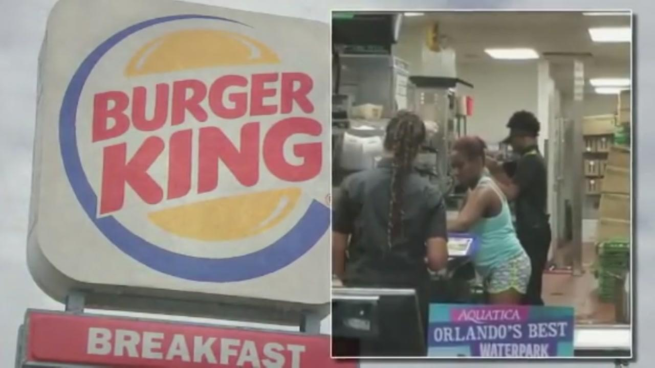 Woman appears to prepare her own food at Burger King