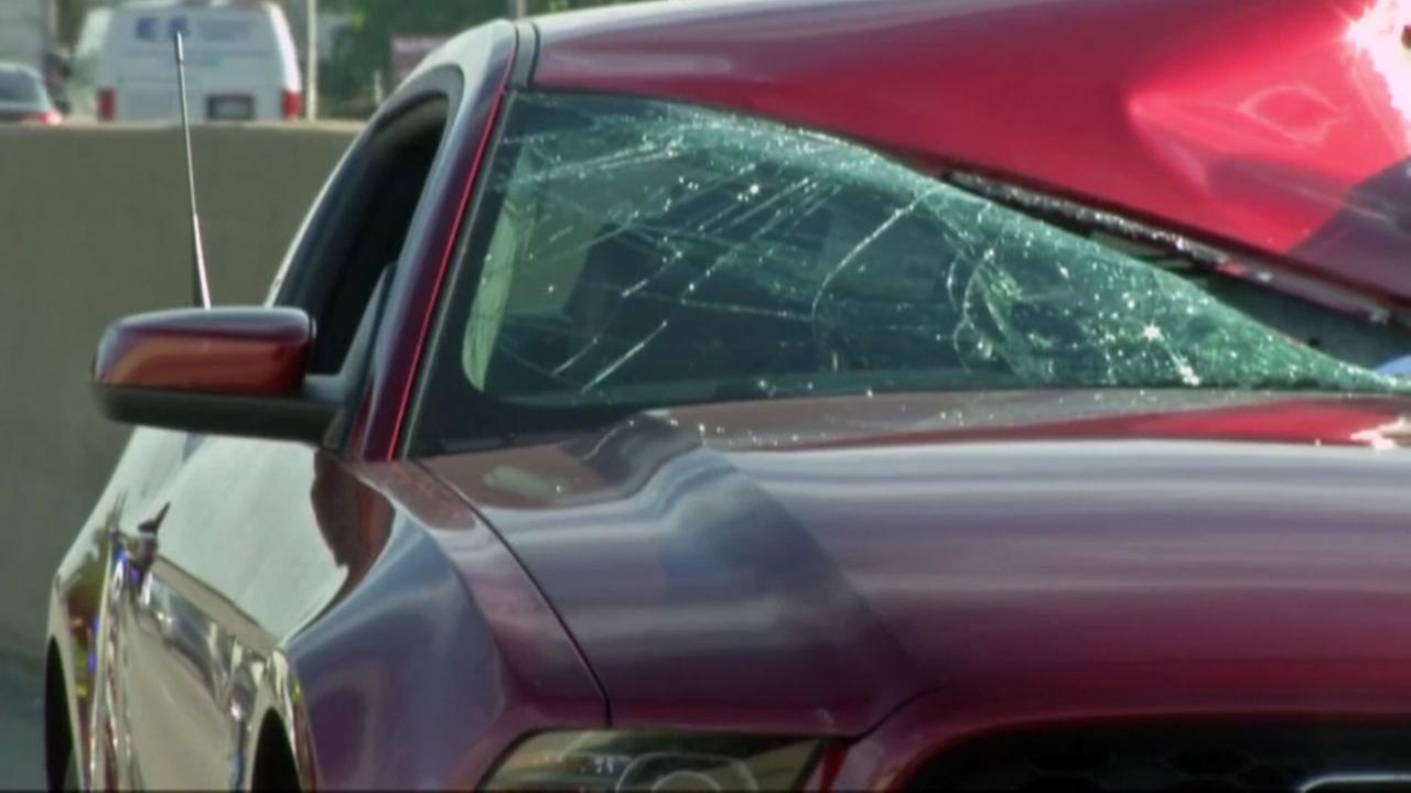 Woman killed after tire hits windshield