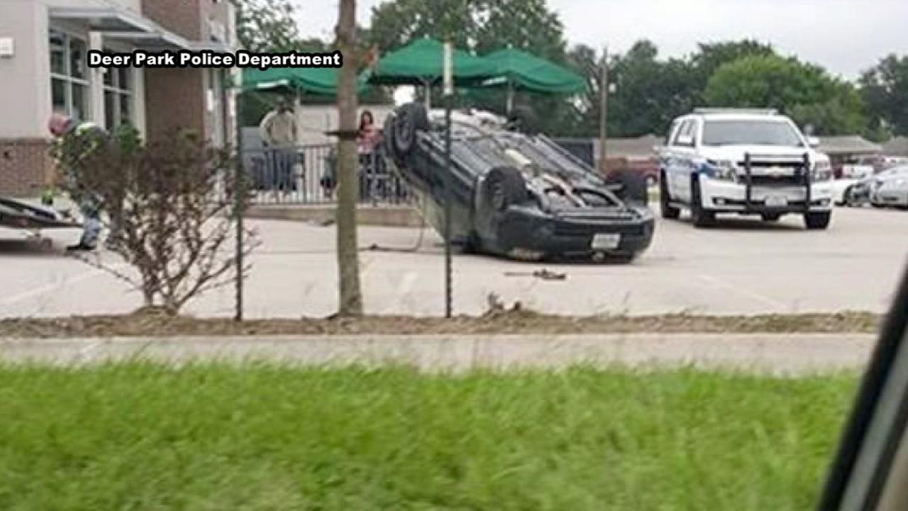 Car flips over at Starbucks