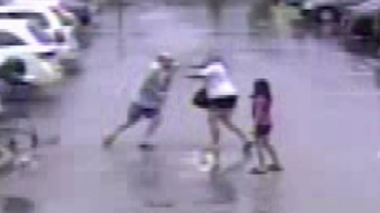 Surveillance cam catches parking lot fight