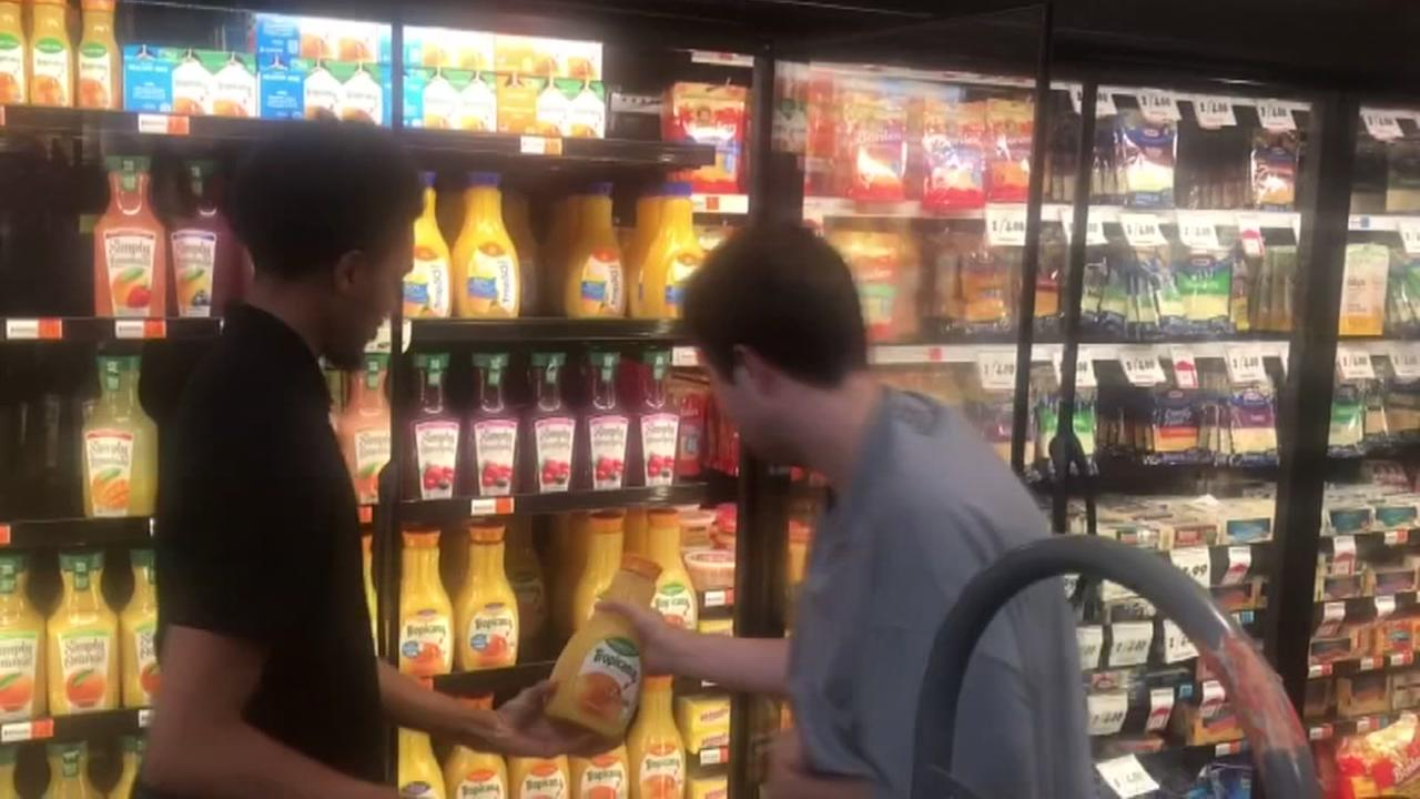 Young teen with autism helps grocery store employee