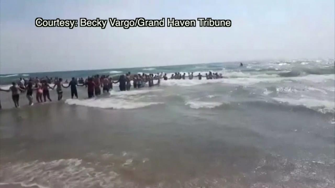 Human chain water rescue at Lake Michigan