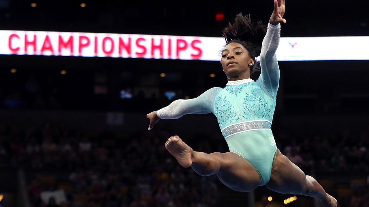 Simone Biles competes on the floor exercise at the U.S. Gymnastics Championships, Sunday, Aug. 19, 2018, in Boston.