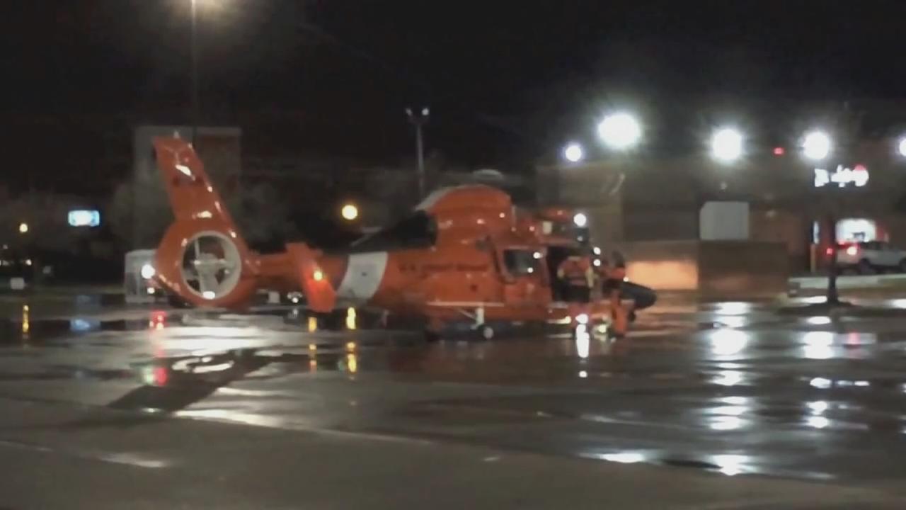 USCG chopper lands in Target parking lot in Kemah