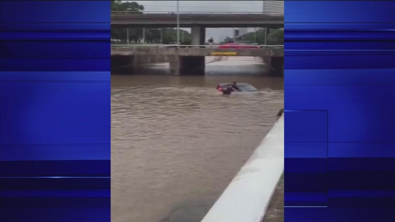 Good Samaritans save woman stuck in flooded car