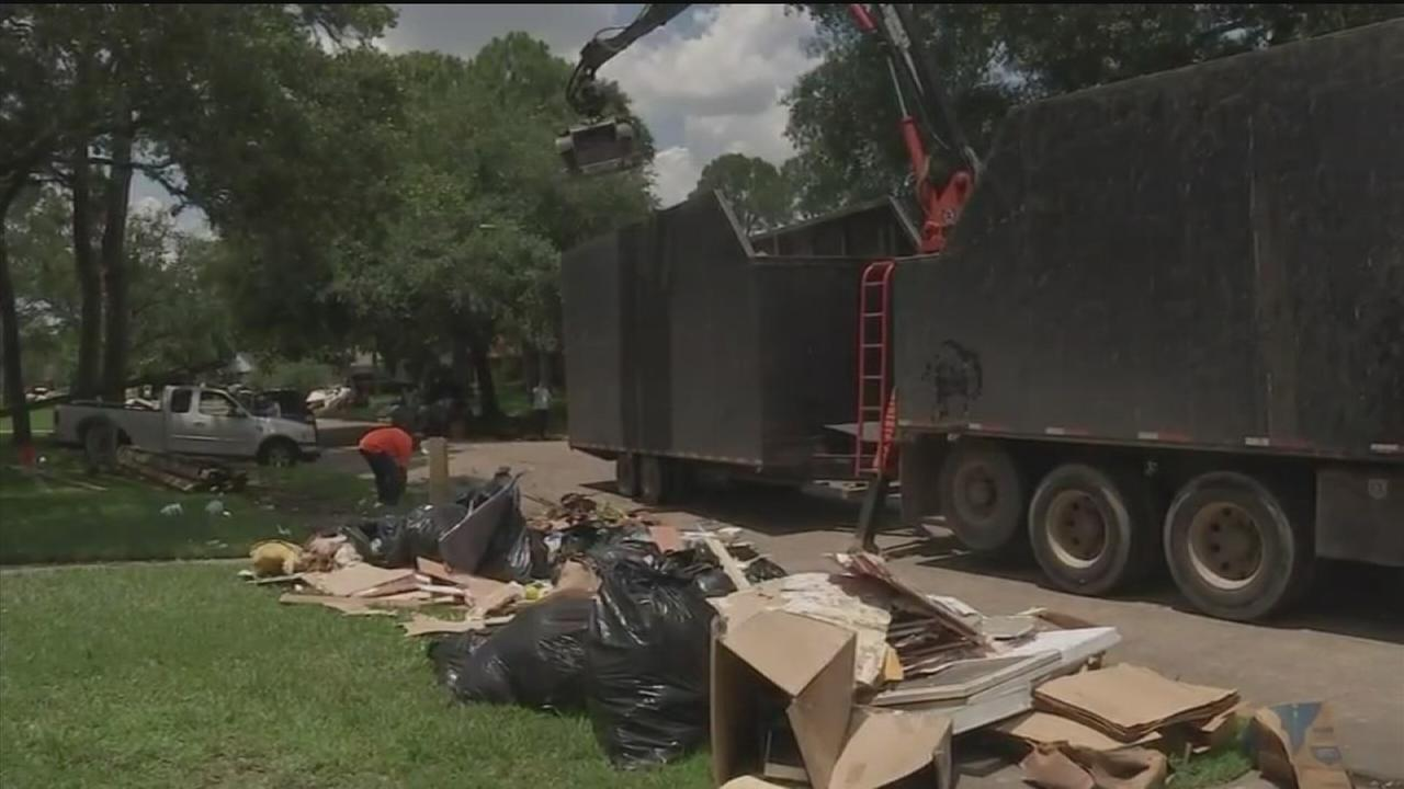 Scavengers leave flood victims with big curbside mess