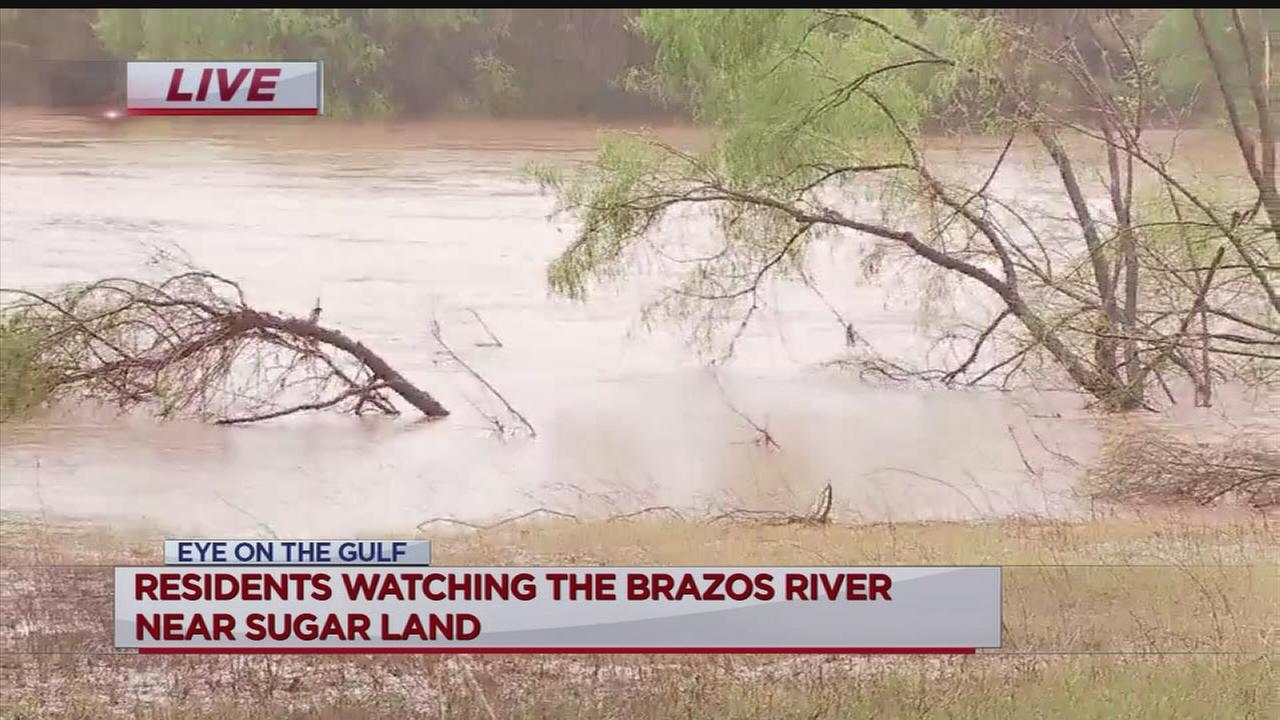 Watching the rising Brazos River