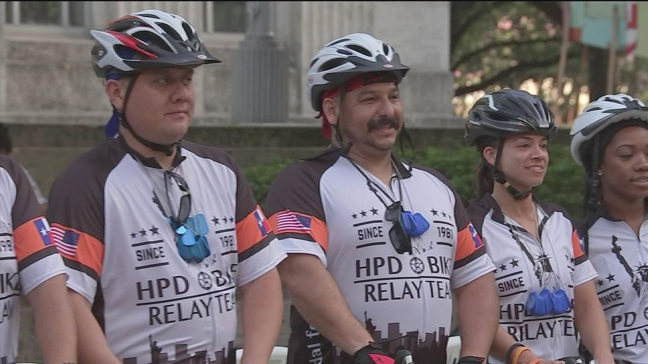 HPD officers bike for miles to raise money