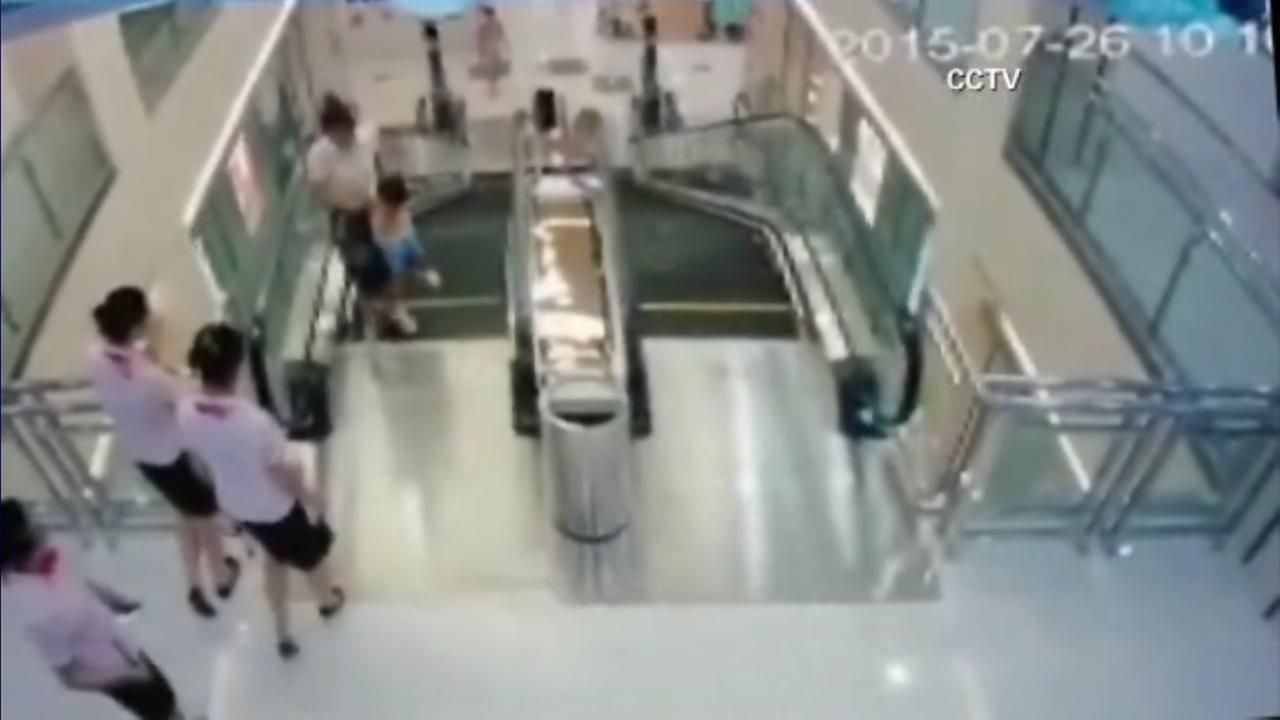 072715-cnn-mom-saves-son-escalator-vid