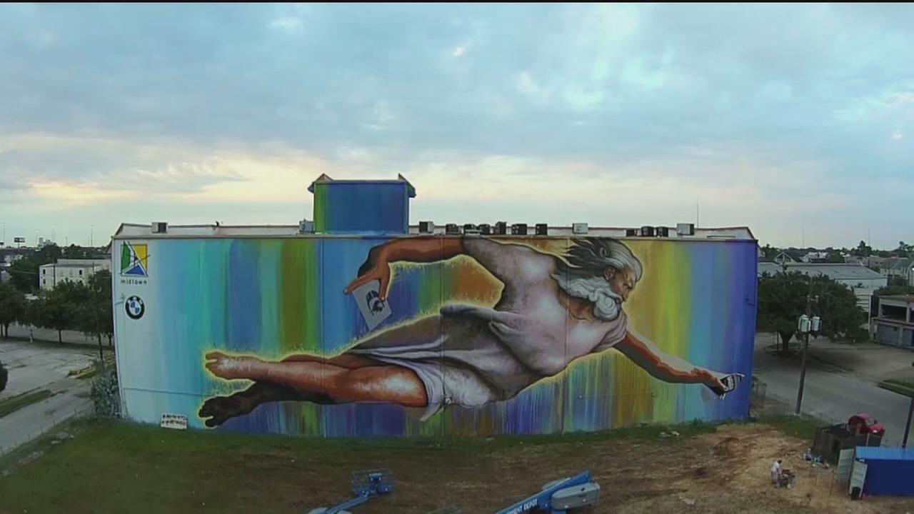 Artist talks massive God mural