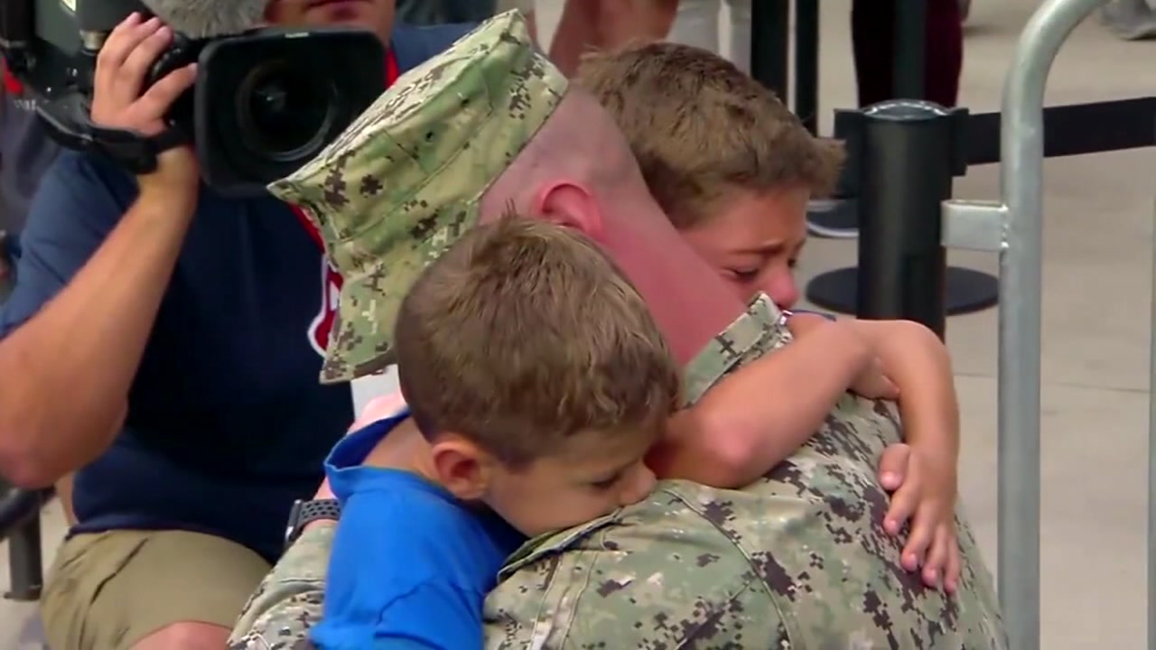 Soldier surprises young boys at baseball game