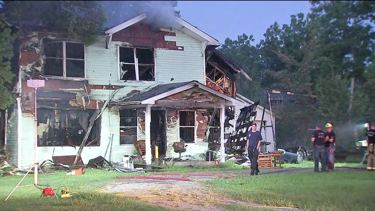 Officials have recovered a body in a burned home in Baytown.
