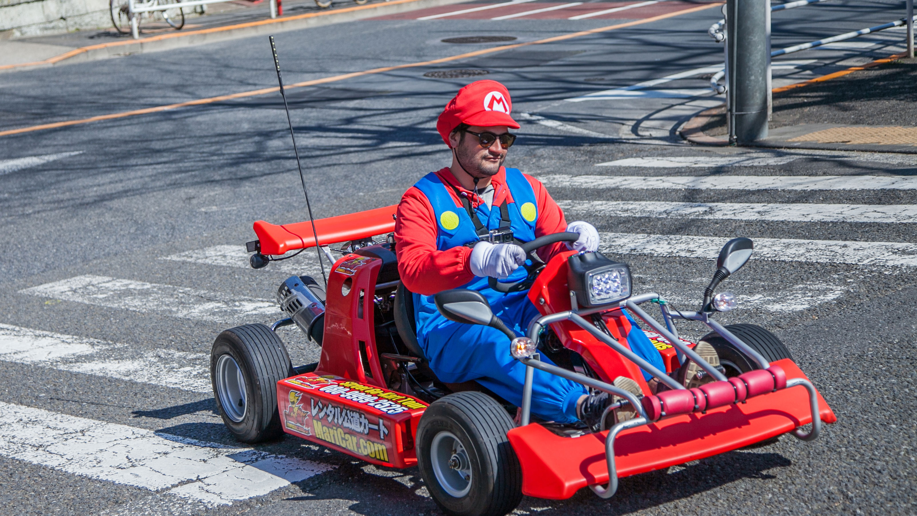 TOKYO,JAPAN - MARCH 12,2017 : Tourist are driving go-karts around on street in Tokyo Japan,This is a favorite activity of tourists.