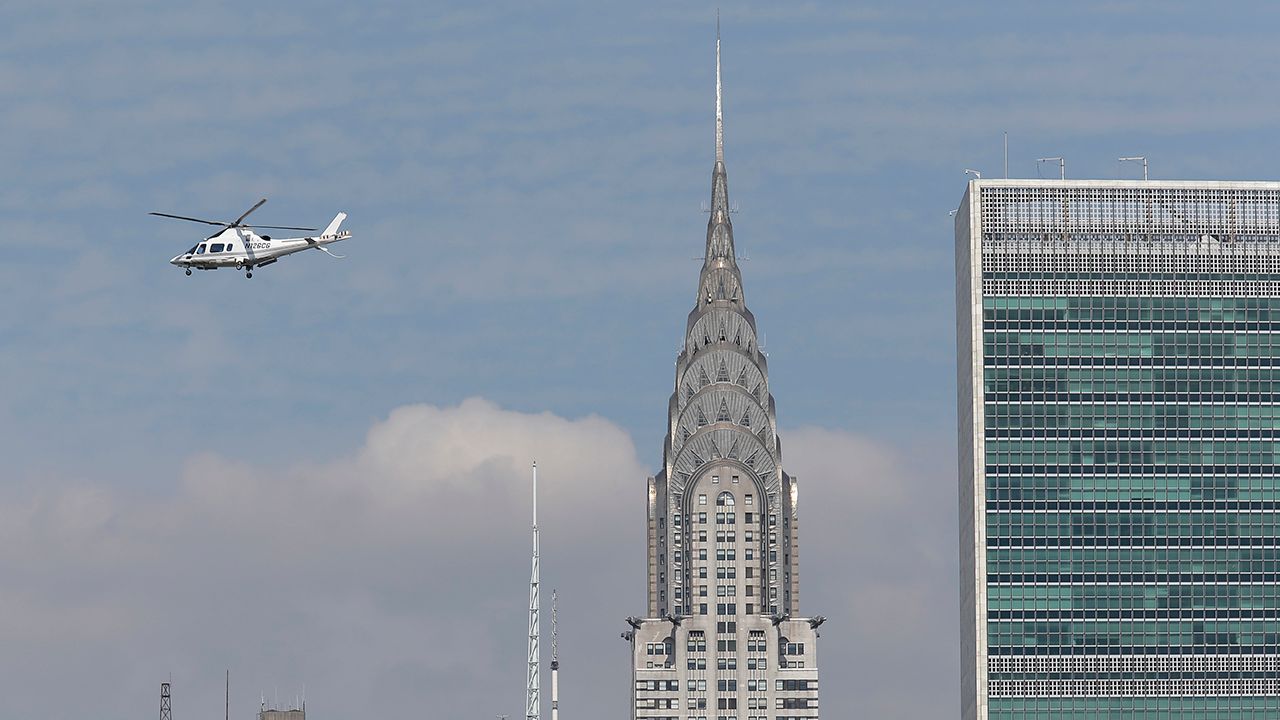 A helicopter passes by the Chrysler Building in New York, Tuesday, July 31, 2018.