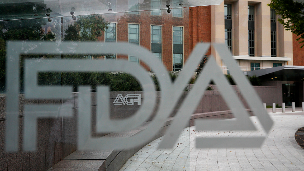 This Aug. 2, 2018, file photo shows the U.S. Food and Drug Administration building behind FDA logos at a bus stop on the agencys campus in Silver Spring, Md.